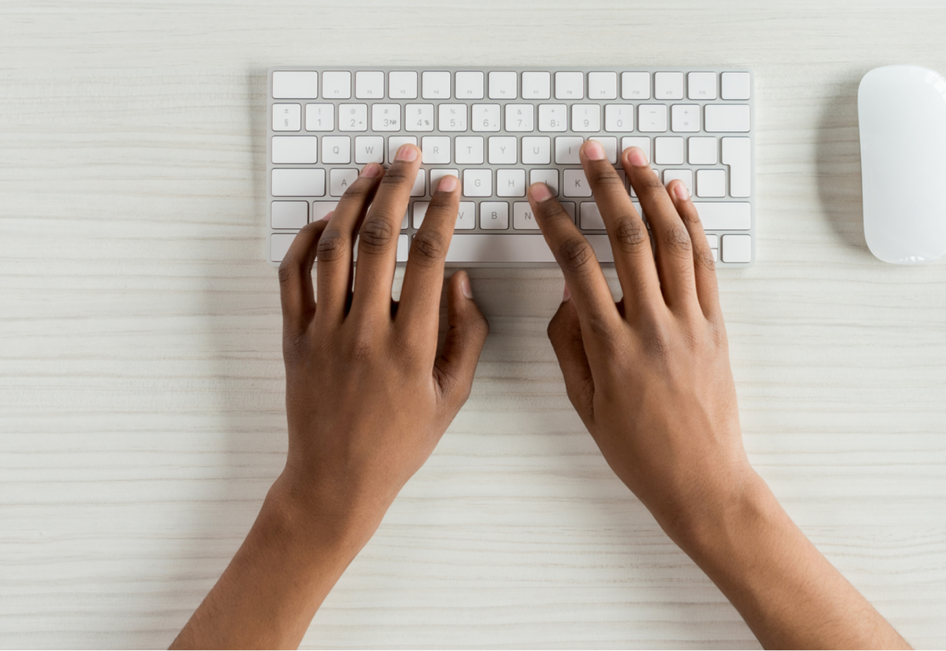Attendees message – hands on a laptop keyboard – will be replaced by African American hands. Shows how anyone can take our course anywhere